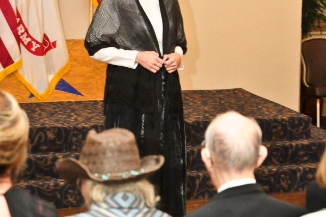 Raylene Gill, a volunteer performer, acts out a speech given by Susan B. Anthony during the Fort Hood Women's Equality Day observance at Club Hood on Fort Hood, Texas, August 26. Gill was one of many performers that participated in the day's equality celebration. (Photo by Staff Sgt. Tony Foster, Division West Public Affairs)