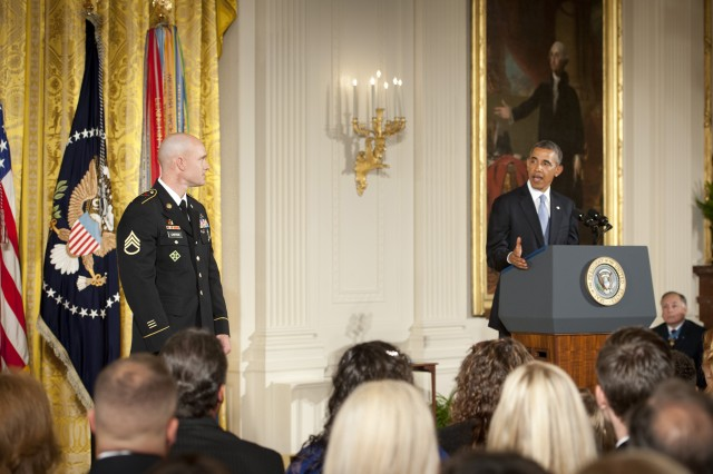 President Barack Obama conveys the heroics of U.S. Army Staff Sgt. Ty Michael Carter to the audience gathered for the Medal of Honor ceremony in Carter's honor at the White House in Washington, D.C., Aug. 26, 2013. Carter was awarded the Medal of Honor for actions during the Battle of Kamdesh at Combat Outpost Keating, Nuristan province, Afghanistan, Oct. 3, 2009. Carter was a cavalry scout with Bravo Troop, 3rd Squadron, 61st Cavalry Regiment, 4th Brigade Combat Team, 4th Infantry Division at the time of the battle.