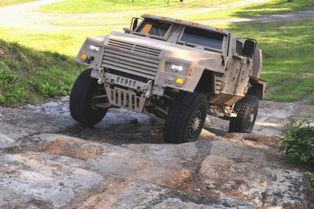 Lockheed Martin's Joint Light Tactical Vehicle prototype negotiates the off-road demonstration course at the Transportation Demonstration Support Area in Quantico, Va.