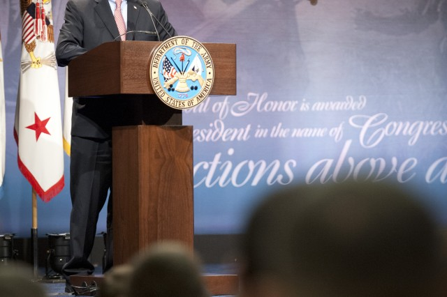 Deputy Secretary of Defense Ashton B. Carter gives remarks during Staff Sgt. Ty Michael Carter's induction ceremony into the Hall of Heroes at the Pentagon, Aug. 27, 2013.