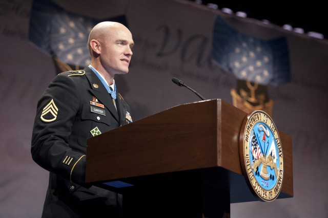Staff Sgt. Ty Michael Carter talking about the support from his family during his induction ceremony into the Hall of Heroes at the Pentagon, Aug. 27, 2013.