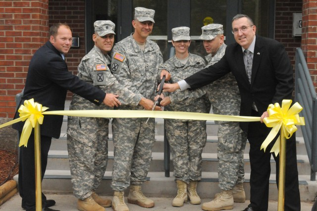 Army and post officials cut the ribbon Thursday, Aug. 29, 2013, during the Army Wellness Center, Fort Drum, N.Y., grand opening ceremony. From left are, Chris Ramie, AWC director; Command Sgt. Maj. Rick Merritt, 10th Mountain Division (LI) senior enlisted advisor; Maj. Gen. Stephen J. Townsend, Fort Drum and 10th Mountain Division (LI) commander; Brig. Gen. Barbara R. Holcomb, U.S. Army Forces Command surgeon; Col. Matthew E. Mattner, Fort Drum's U.S. Army Medical Department Activity commander; and Michael H. McKinnon, deputy to the garrison commander.
