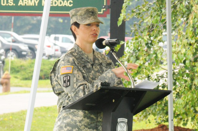 Brig. Gen. Barbara R. Holcomb, U.S. Army Forces Command surgeon, speaks to the audience Thursday, Aug. 29, 2013, during the Army Wellness Center, Fort Drum, N.Y., grand opening ceremony.