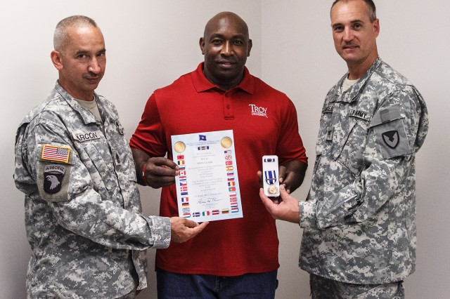 John Clark, center, earned the Non-Article 5 North Atlantic Treaty Organization Medal for repairing M2A1 machine guns while deployed as a civilian to Afghanistan. Clark, a small arms repairer at Anniston Army Depot is pictured with Commander Col. Brent Bolander, right, and Sgt. Maj. Jeffrey Marcon.