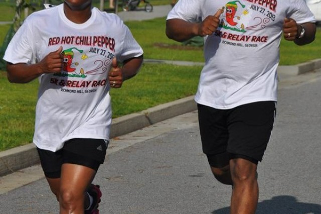 Sgt. 1st Class Shenece Rue and her husband  broke a heavy sweat during the recent Red Hot Chili Pepper Run, Richmond Hill, Ga. This run raised money to renovate homes to house orphans in Georgia, Florida, and South Carolina. Rue regularly donates her time to volunteering and encourages others within the 188th to do the same.