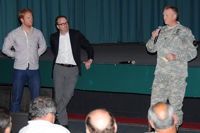 """Col. Stuart J. McRae, Fort Rucker garrison commander, stands with actor Brendan Griffin and Bryan Doerries, Outside the Wire artistic director, and talks to the audience and shares his experience during the alcohol abuse awareness training at the post theater in May. The """"Theater of War"""" production is also put on by Outside the Wire and is a dramatic reading of scenes from Sophocles' """"Ajax,"""" an ancient Greek war play that will come to Fort Rucker Sept. 5 to bring awareness for Suicide Prevention Month."""