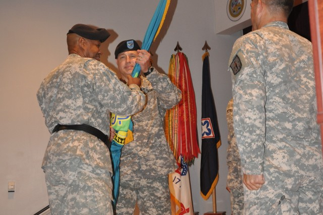 Col. (Promotable) Paul Chamberlain, right, accepts the colors of the Soldier Support Institute from Maj. Gen. Larry Wyche, commanding general of the Combined Arms Support Command, during a ceremony Aug. 22 at the SSI auditorium. Chamberlain took over for Col. Todd Garlick.