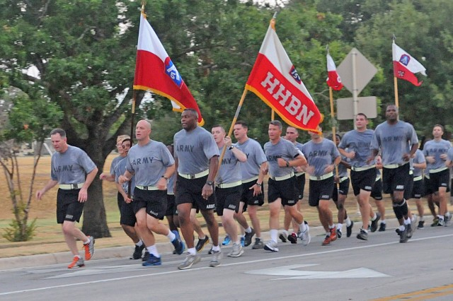 Maj. Gen. Perry Wiggins (left), deputy commanding general, U.S. Army North (Fifth Army), leads the Soldiers of Headquarters and Headquarters Battalion, Army North, on their way home Aug. 29 from a Labor Day run. As the Army returns to its roots, what better way to demonstrate resiliency than with a run across Fort Sam Houston; Few traditions are as deep as breaking a sweat as a team. (U.S. Army photo by Sgt. 1st Class Christopher DeHart, Army North PAO)