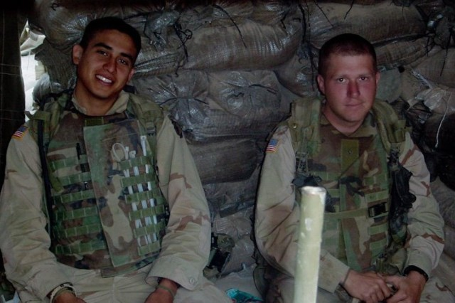 Task Force Vigilant Unit Ministry noncommissioned officer in charge Staff Sgt. Robert Mathis (right) listens to a mission brief in his unit's command post while operating in the outskirts of Kandahar, Afghanistan, in 2002. Mathis was once an infantryman and now serves as a chaplain's assistant, supporting 18th Military Police Brigade soldiers while on deployment and their families back home.