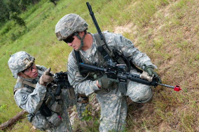 Infantrymen with the 82nd Airborne Division's 1st Brigade Combat Team identify potential enemy positions on the field before them and outline a plan of attack, Aug. 20, at Fort Bragg, N.C. During the daylong training the paratroopers honed their skills of identifying the enemy at various distances and of clearing a building of an enemy presence. (U.S. Army photo by Staff Sgt. Mary S. Katzenberger)