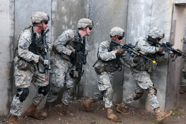 Infantrymen with the 82nd Airborne Division's 1st Brigade Combat Team move to the clear the second room in a building during squad attack training, Aug. 20, at Fort Bragg, N.C. The infantryman cleared the room firing blank rounds, and later moved to firing live ammunition into targets located throughout the building. (U.S. Army photo by Staff Sgt. Mary S. Katzenberger)