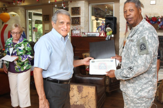 "FORT SAM HOUSTON, Texas - Jim Salaiz is presented a certificate of appreciation by Maj. Gen. Adolph McQueen Jr., deputy commanding general for support, U.S. Army North (Fifth Army), Aug. 22 for his volunteer efforts at the Warrior and Family Support Center throughout the years. McQueen presented certificates, personal notes of appreciation and Army North lapel pins to Salaiz and nine fellow WFSC volunteers for their dedication during two separate ceremonies Aug. 20 and 22.  ""I cannot thank you enough for the service you provide to our wounded warriors,"" said McQueen. ""We can't measure what you give in dollars; we can only measure it in smiles."" (U.S. Army photo by Staff Sgt. Corey Baltos, Army North PAO)"