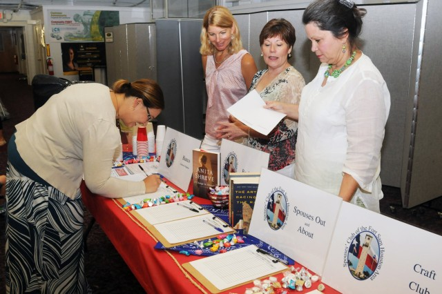 FORT SAM HOUSTON, Texas - Shari Calder (center), Mary Ann Haun and Pat Kirk help a new member sign up for the Bunco club during the Fort Sam Spouses' Club membership drive and luncheon Aug. 27 at the Army Community Services building. Kirk is the chairperson for the Spouses' Club book club while Calder and Haun are the day and evening Bunco coordinators respectively. (U.S. Army photo by Sgt. 1st Class Christopher DeHart, Army North PAO)