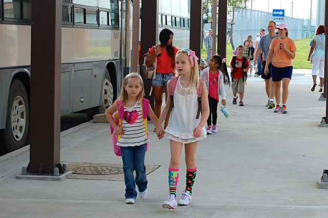 Humphreys Central Elementary School students arrived via bus, car, taxi and foot Aug. 26, as the new school year begins here. After participating in an early morning program, the students said the Pledge of Allegiance and then were led by their teachers to their classrooms.