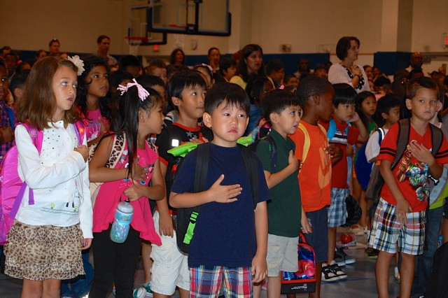 Humphreys Central Elementary School students arrived via bus, car, taxi and foot Aug. 26, as the new school year begins here. After participating in an early morning program, the students said the Pledge of Allegiance and were then led by their teachers to their classrooms.