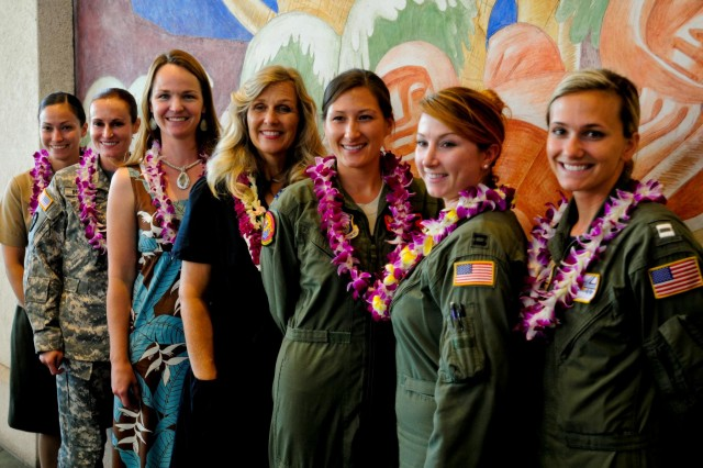 The panel of female aviators from the Army, Air Force, Navy, and Marines gather for a group photo after the Women Airforce Service Pilot lecture during the 7th Annual Distinctive Women in Hawaiian History Program in Honolulu Aug. 25.