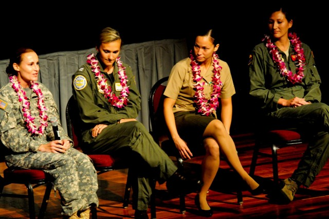 Chief Warrant Officer 2 Allison Morgan, a UH-60 pilot from Company C, 3rd Battalion, 25th Aviation Regiment, 25th Combat Aviation Brigade, 25th Infantry Division, shares her Army experiences with fellow female aviators from the Navy, Air Force and Marines to the crowd during the 7th Annual Distinctive Women in Hawaiian History Program in Honolulu Aug. 25.