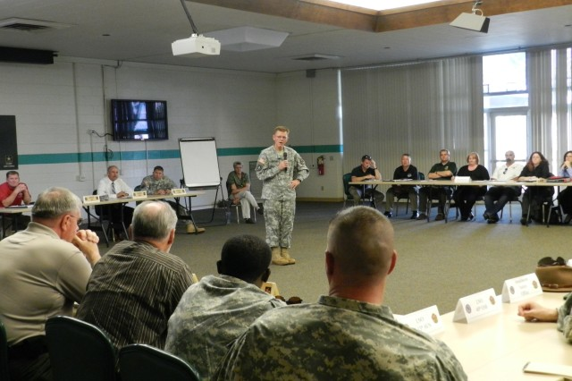 Col. Dan McFarland, Fort Huachuca garrison commander, speaks at a briefing Tuesday after the conclusion of Apache Warrior 2013. Two after-action briefings took place at Murr Community Center Tuesday and Wednesday for all units and agencies involved.