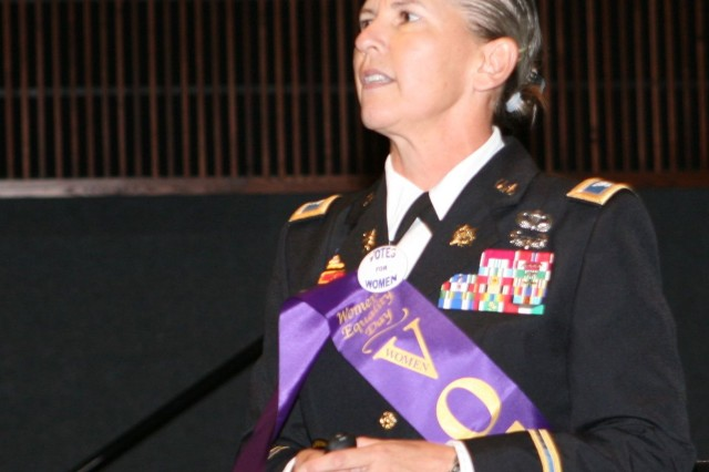 Guest speaker Col. Lisa Price, deputy commander for training, United States Army Intelligence Center of Excellence, represented Women's Equality Day by wearing a sash and button in honor of women's voting rights at the observance in Alvarado Hall on Wednesday.