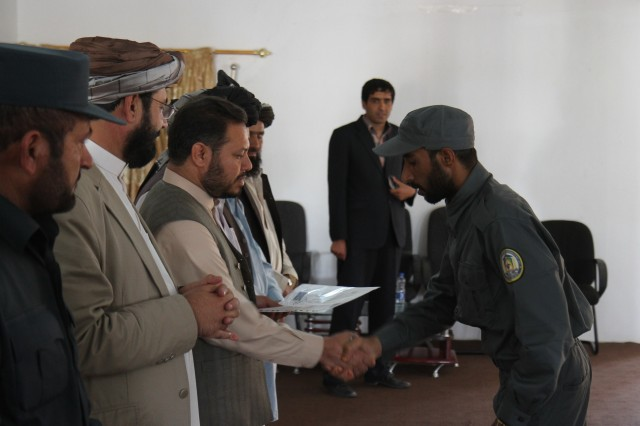 "PAKTIKA PROVINCE, Afghanistan "" A recent Afghan Local Police graduate receives his course completing certificate during an ALP graduation ceremony held at the National Directorate of Security compound adjacent to Forward Operating Base Rushmore, Afghanistan, Aug 28, 2013. The graduating class of approximately 70 ALP is the first to attend the all Afghan ran local police training academy in Paktika Province. The ALP is an effective, cost efficient, resilient, and accountable component of GIRoA security forces as they provide security to the local populace. The relevance of the ALP is demonstrated by its recognition as an integral part of the Afghan National Security Force structure, by its popularity with local leaders and people, and by the danger it poses to the insurgency. (Photo by U.S. Army Sgt. Mark A. Moore II "" 2/10 Security Forces Assistance Brigade)"