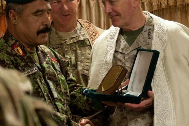 NANGARHAR PROVINCE, Afghanistan - Afghan National Army Maj. Gen. Mohammad Waziri (left), commander, 201st Corps, presents a gift to Boston, native, U.S. Marine Corps Gen. Joseph Dunford, Jr. (right), commander, International Security Assistance Force and U.S. Forces-Afghanistan, at the end of the Dunford's visit to Forward Operating Base Fenty, Nangarhar province, Afghanistan, Aug. 26, 2013. Quincy, Mass., native, U.S. Army Maj. Gen. James McConville, commander, 101st Airborne Division (Air Assault) and Regional Command-East, looks on. Dunford met with Afghan National Security Force leaders and regional government officials from eastern Afghanistan's Nuristan, Kunar and Nangarhar provinces to discuss plans for the remainder of 2013. (U.S. Army National Guard photo by Sgt. Margaret Taylor, 129th Mobile Public Affairs Detachment/RELEASED)