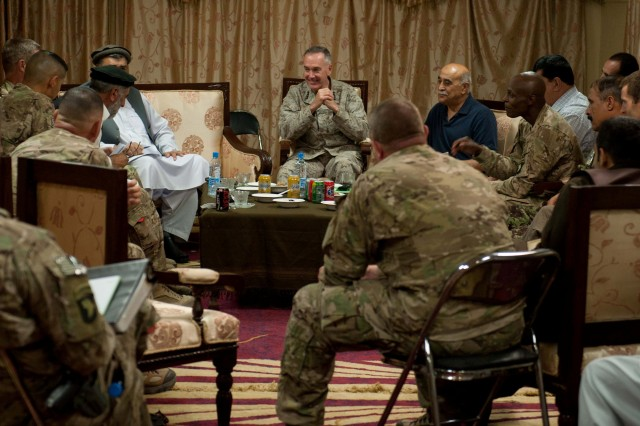 """NANGARHAR PROVINCE, Afghanistan - """" U.S. Marine Corps Gen. Joseph Dunford, Jr. (center), commander, International Security Assistance Force and U.S. Forces-Afghanistan, speaks with regional Afghan government officials during his visit to Forward Operating Base Fenty, Nangarhar province, Afghanistan, Aug. 26, 2013. Dunford, a Boston, Mass., native, met with Afghan National Security Force leaders and regional government officials from eastern Afghanistan's Nuristan, Kunar and Nangarhar provinces to discuss plans for the remainder of 2013. (U.S. Army National Guard photo by Sgt. Margaret Taylor, 129th Mobile Public Affairs Detachment/RELEASED)"""