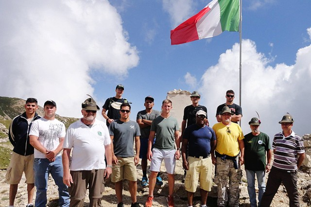 Workhorse Company Soldiers and their Italian hosts pose for a picture on the historic battlefield heights.