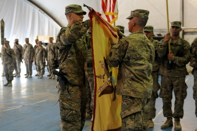 U.S. Army Lt. Col. David D. Dean (left), commander of the 157th Combat Sustainment Support Battalion and Master Sgt. Robert F. Harris (right), acting command sergeant major for the 157th Combat Sustainment Support Battalion, roll their colors as they prepare to case them during their transfer of authority to the 77th Combat Sustainment Support Battalion, Sept. 1, 2013, at Bagram Air Field, Parwan province, Afghanistan. The 157th CSSB is based out of Willow Grove, Pa. www.facebook.com/lifeliner (U.S. Army photo by Sgt. Sinthia Rosario, Task Force Lifeliner Public Affairs)