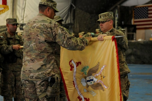 U.S. Army Lt. Col. Hector L. Agosto Rivera (left), a native of Salinas, Puerto Rico, and commander of the 77th Combat Sustainment Support Battalion (CSSB), and U.S. Army Sgt. Maj. Waldemar Rodriguez Diaz (right), a native of Juana Diaz, Puerto Rico, and command sergeant major for the 77th Combat Sustainment Support Battalion, unfurl their colors during the transfer of authority from the 157th Combat Sustainment Support Battalion, Sept. 1, 2013, at Bagram Air Field, Parwan province, Afghanistan. The 77th CSSB is a U.S. Army Reserve unit from Aguadilla, Puerto Rico. www.facebook.com/lifeliner (U.S. Army photo by Sgt. Sinthia Rosario, Task Force Lifeliner Public Affairs)