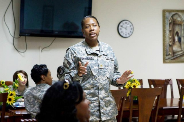 "U.S. Army Maj. Veleka Henderson, the senior intelligence officer for Area Support Group-Qatar, spearheads the ""Sisters in Arms"" program at the women's luncheon held on Camp As Sayliyah, Aug. 28."