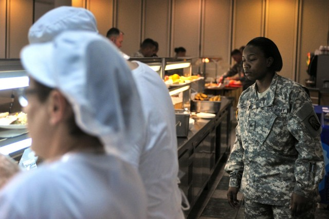 U.S. Army Sgt. Lakisha N. Green, a food service noncommissioned officer assigned to the 16th Sustainment Brigade and a native of Tallahassee, Fla., inspects the food service line at a dining facility during Operation Immediate Response 13 at Zrinski Barracks Aug. 26. Green was a member of the IR13 Mayor's Cell responsible for ensuring food was properly distributed to exercise participants.