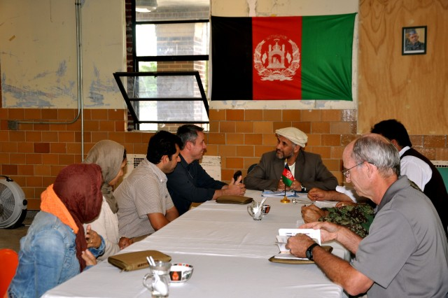 Personnel from the Department of State, Department of Agriculture, the U.S. Agency for International Development, participate in a key leadership engagement during the Foreign Service Institute training at Muscatatuck Urban Training Center, Ind. The Foreign Service Institute, the training arm of the State Department, mandates all government civilians attend training before they deploy.