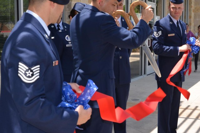 Air Force Col. Robert Borja, commander, 369th Recruiting Group, based in San Antonio, cuts the ribbon July 31, officially opening the new look Air Force Recruiting Service office in Austin, Texas.