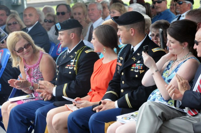 Annette Wiggins (left), wife of Lt. Gen. Perry Wiggins, looks down the row at their family during a change-of-command ceremony, Sept. 4, 2013, in the historic Quadrangle on Fort Sam Houston, Texas. Wiggins, who previously served as the deputy commanding general for U.S. Army North (Fifth Army), was promoted prior to the ceremony to the rank of lieutenant general and then assumed duties as commanding general, Army North, and senior commander for Fort Sam Houston and Camp Bullis.