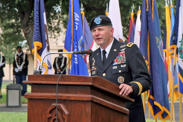 Lt. Gen. Perry Wiggins, the newest commanding general for U.S. Army North (Fifth Army) and senior commander for Fort Sam Houston, Texas, and Camp Bullis, gives a heartfelt speech during his change-of-command ceremony, Sept. 4, 2013, in the historic Quadrangle on Fort Sam Houston.