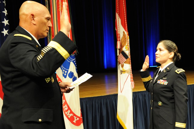 Army Chief of Staff Gen. Ray Odierno administers the oath of office to newly promoted Lt. Gen. Flora D. Darpino who became the Army's first woman to serve as Judge Advocate General of the Army. Darpino was promoted and administered the oath at a Pentagon ceremony, held Sept. 4, 2013.
