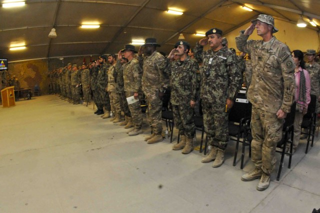 KANDAHAR AIRFIELD, Afghanistan -- U.S. Army and Afghan National Army Soldiers and members of coalition forces render a salute during the playing of The Star Spangled Banner and the Islamic Republic of Afghanistan national anthem during a ceremony Sept. 5, 2013, at Kandahar Airfield, Afghanistan.  The ceremony formally marked Combined Task Force Dragoon's assumption of responsibility over all Kandahar Province.