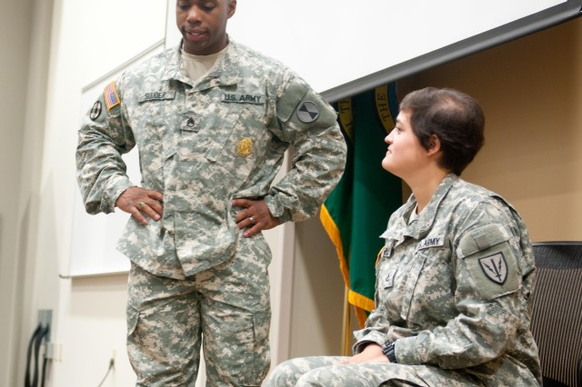 Staff Sgt. Dereck Souder, Victims Advocate, 7th Infantry Division and Pfc. Victoria Dalrymple, cryptologic linguist, 109th Military Intelligence Battalion, participate in a role playing exercise showing the signs of sexual harassment and discuss when a peer should intervene during a check on learning. The course, similar to Sexual Assault Response Coordinators and Victims advocacy training, was conducted Aug 26-29, on Joint Base Lewis McChord and first here.