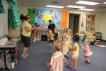 VBS volunteers lead students through dance and song singing routine