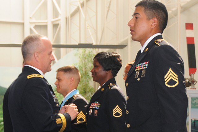 Maj. Gen. Kevin W. Mangum, U.S. Army Aviation Center of Excellence and Fort Rucker commanding general, and Command Sgt. Maj. James H. Thomson Jr., command sergeant major of the Aviation Branch, induct Sgt. First Class Lonnie Gilstrap, A Co., 1st Bn. 13th Avn. Regt., Staff Sgt. Erica Stewart, C Co., 1st Bn. 13th Avn. Regt, and Staff Sgt. Armando Frias, 597th Maintenance Detachment, 164th Theater Airfield Operations Group, into the Sergeant Audie Murphy Club during a ceremony at the U.S. Army Aviation Museum Aug. 30.