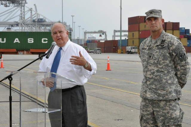 Under Secretary of the U.S. Army Dr. Joseph W. Westphal gives a press conference at the Port of Savannah, Ga., (Garden City Ocean Terminal) to discuss the economic value of the Savannah Harbor Expansion Project, Sept. 4, 2013. Next to Westphal is Col. Thomas Tickner, commander of the U.S. Army Corps of Engineers Savannah District. The corps is the lead federal agency for the SHEP-a plan to deepen the federal shipping channel from 42 feet to 47 feet to accommodate larger ships and increase shipping efficiencies. The project is slated to bring a net benefit of $174 million annually to the nation.