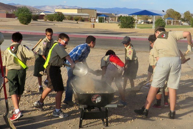 Boy Scout Troop 67 on Fort Irwin helped with the cleanup effort by shoveling dirt and debris from a residential street near Fort Irwin Middle School.