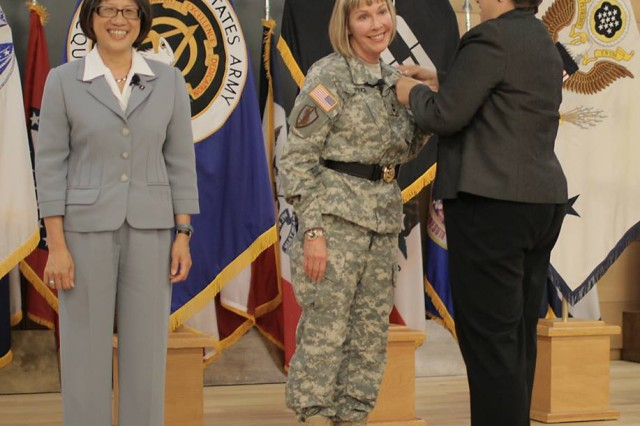 Maj. Gen. N. Lee S. Price (center) receives her retirement pin from retired Col. Sam Lietz (right).  The Honorable Heidi Shyu (left), Army Acquisition Executive and Assistant Secretary of the Army for Acquisition, Logistics and Technology, served as host for both the Program Executive Office for Command, Control and Communications-Tactical (PEO C3T) Change of Charter and Price's retirement ceremonies at Aberdeen Proving Ground, Md. on Sept. 4.