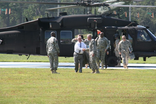 Under Secretary of the Army Dr. Joseph W. Westphal is greeted by Maj. Gen. John M. Murray and Command Sgt. Maj. Edd Watson upon the Under Secretary's arrival at Fort Stewart, Ga., Sept. 5, 2013. The purpose of Westphal's visit was to underscore the versatility of the force to posture for future requirements and as well as to highlight the concerns of senior Army leaders about the impact of fiscal constraints (furloughs) and reinforce the value/contributions of the Department of the Army Civilian workforce and their families.