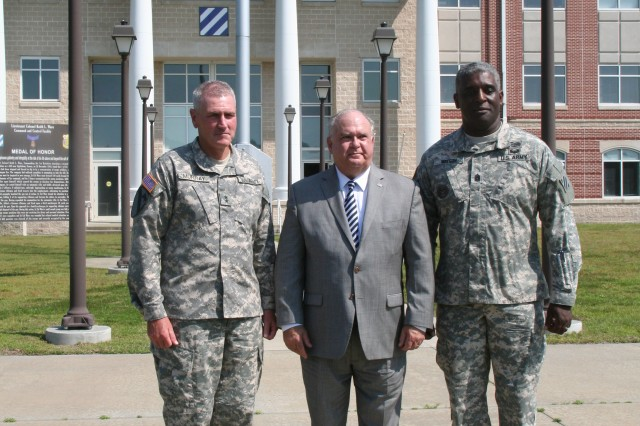 Under Secretary of the Army Joseph W. Westphal is greeted by Maj. Gen. John M. Murray and Command Sgt. Maj. Edd Watson upon the Under Secretary's arrival at Fort Stewart, Ga., Sept. 5, 2013. The purpose of Westphal's visit was to underscore the versatility of the force to posture for future requirements and as well as to highlight the concerns of senior Army leaders about the impact of fiscal constraints (furloughs) and reinforce the value/contributions of the Department of the Army Civilian workforce and their families.