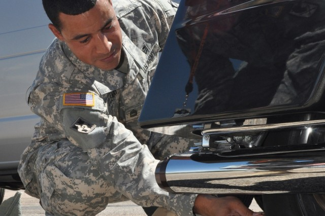 Master Sgt. Brian O'Leary gives a tip to measuing tread depth by using a coin.