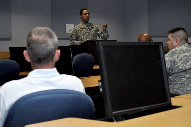 Master Sgt. Brian O'Leary talks to Soldiers and Civilians attending the Motorcycle 101 training Aug. 26, in the Digital Training Facility at Fort Huachuca, Ariz.