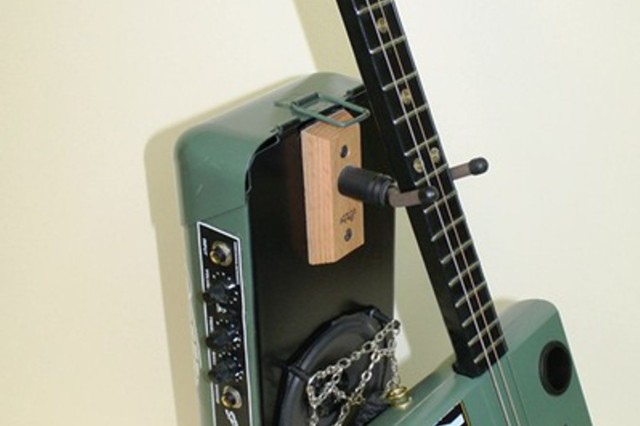"""Staff Sgt. Charles Raby of Fort Hood, Texas, takes first place in the novice artists' mixed media category of the 2013 Army Arts & Crafts Contest with """"Army Cigar Box Guitar Tactical Unit."""""""