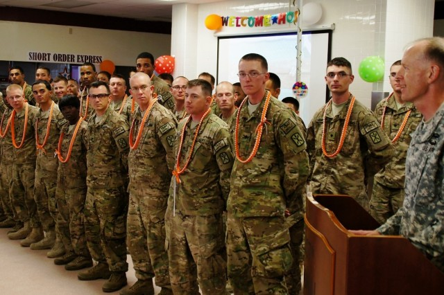 Lt. Col. Mark Miles (right), Commander 307th ESB, welcomes back 30 Co. A Soldiers redeployed from Afghanistan, August 6, at the battalion dining facility on Helemano Military Reservation.  The remaining Soldiers will return over the next few months.