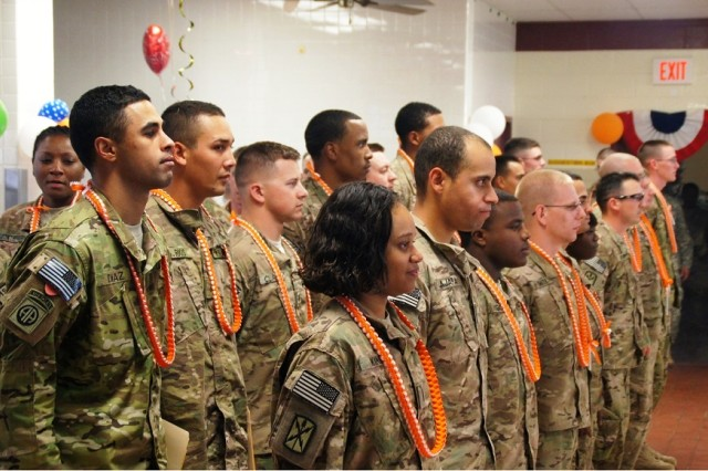 The first group of redeployed Co. A Soldiers make their way into the 307th Expeditionary Signal Battalion Dining Facility, as family and fellow Soldiers welcome and applaud their arrival, August 6, at Helemano Military Reservation.